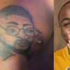 Die-Hard Davido fan tattoos his face on his chest (Photos)